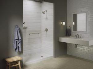 Modern bathroom with grey walls and a white walk-in shower