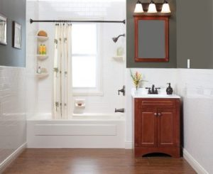 Small remodeled bathroom with a tub, shower, and vanity